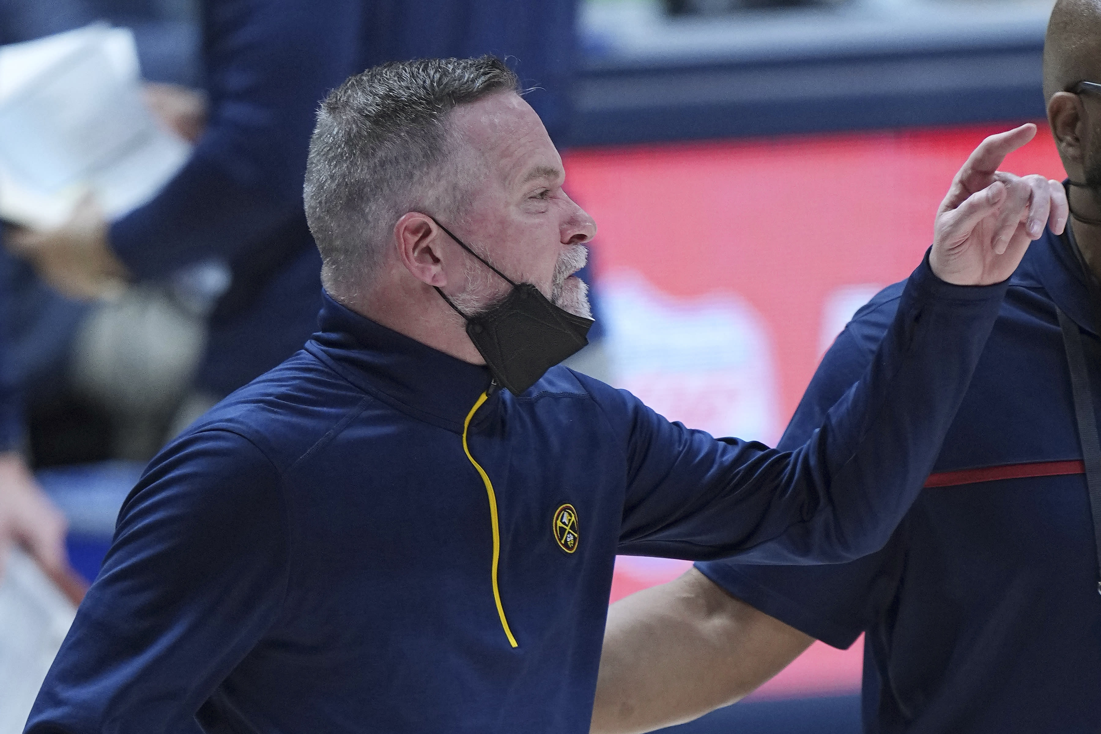 Denver Nuggets coach Michael Malone reacts after being ejected during the second quarter of the team's NBA basketball game against the San Antonio Spurs on Wednesday, April 7, 2021, in Denver. (AP Photo/Jack Dempsey)
