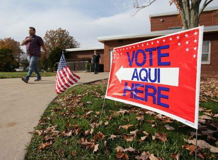FILE PHOTO: Voters leave a polling station after casting their votes during the U.S. presidential election in Olmsted Falls, Ohio, U.S. on November 8, 2016. REUTERS/Aaron Josefczyk/File Photo