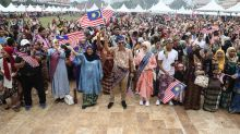 On Malaysia Day, citizens band together for a train ride in 'sarong'