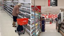 Elderly woman breaks down in tears after staring at empty Coles shelves