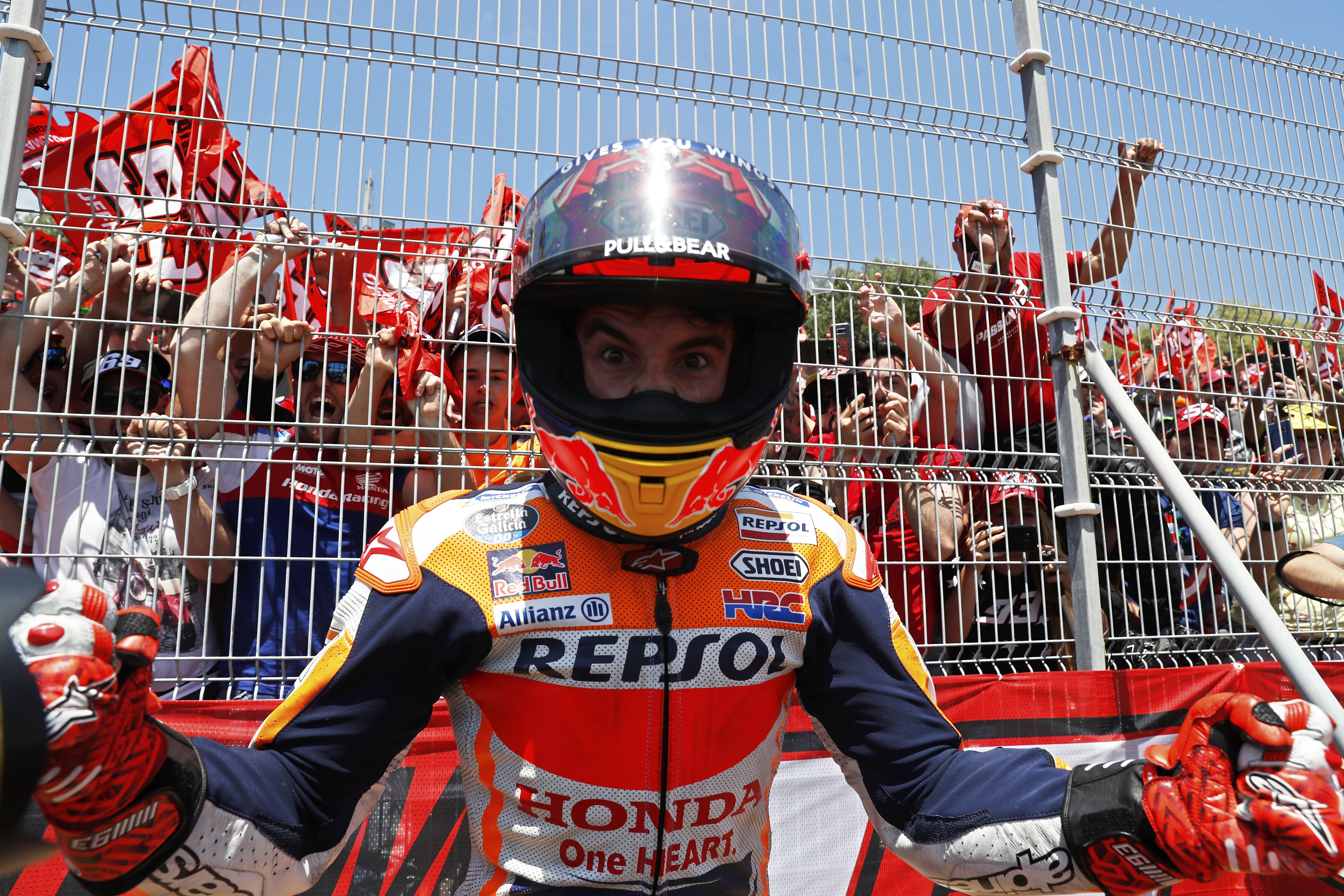 MotoGP rider Marc Marquez of Spain, center, celebrates with fans by the side of the track after winning the Spanish Motorcycle Grand Prix at the Angel Nieto racetrack in Jerez de la Frontera, Spain, Sunday, May 5, 2019. (AP Photo/Miguel Morenatti)