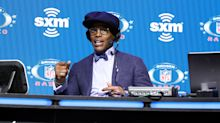 Cam Newton responds to Jeff Garcia slamming his clothes: 'I'm not changing the way I dress'