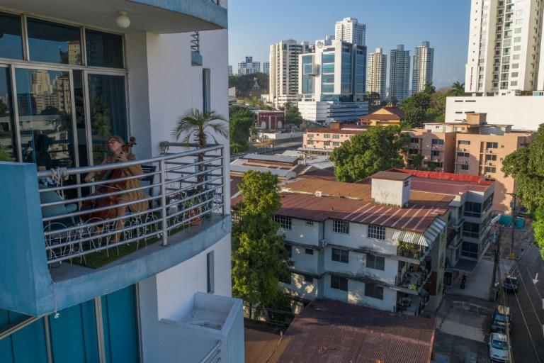 Uruguayan cellist Karina Nunez plays on the balcony of her Panama City apartment during the mandatory lockdown to halt the spread of the deadly new coronavirus