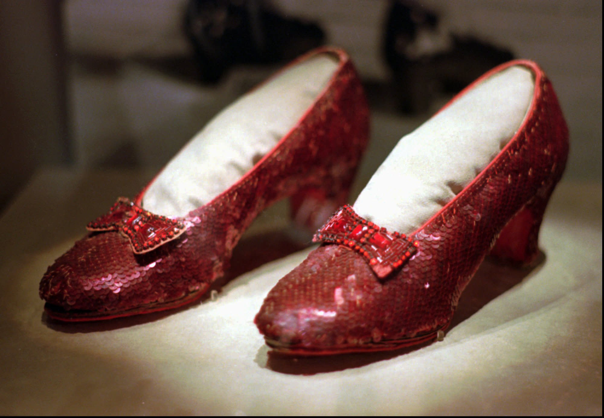"FILE - This April 10, 1996, file photo shows one of the four pairs of ruby slippers worn by Judy Garland in the 1939 film ""The Wizard of Oz"" on display during a media tour of the ""America's Smithsonian"" traveling exhibition in Kansas City, Mo. Federal authorities say they have recovered a pair of ruby slippers worn by Garland that were stolen from the Judy Garland Museum in Grand Rapids, Minn., in August 2005 when someone went through a window and broke into the small display case. The shoes were insured for $1 million. (AP Photo/Ed Zurga, File)"