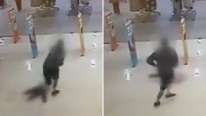 Shocking moment dad hurls girl into security gate