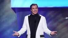 Fans are digging John Travolta's new bald look: 'Hair is so overrated'