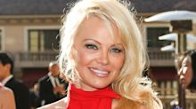 Pamela Anderson wears her iconic 'Baywatch' swimsuit to hang out at home: 'It still fits'