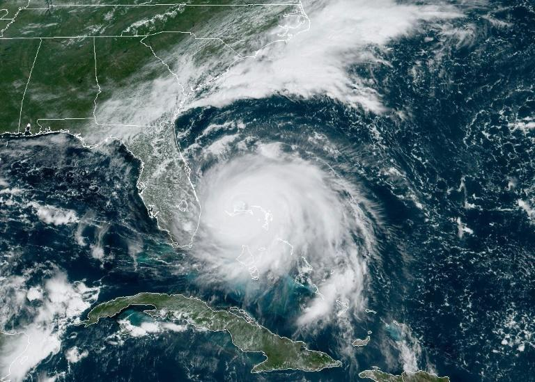 Hurricane Dorian broke into the record books on Sunday when its maximum sustained winds of 185 mph (300 kph) tied it in second place with 1998's Gilbert and 2005's Wilma as the most powerful Atlantic storm since 1950
