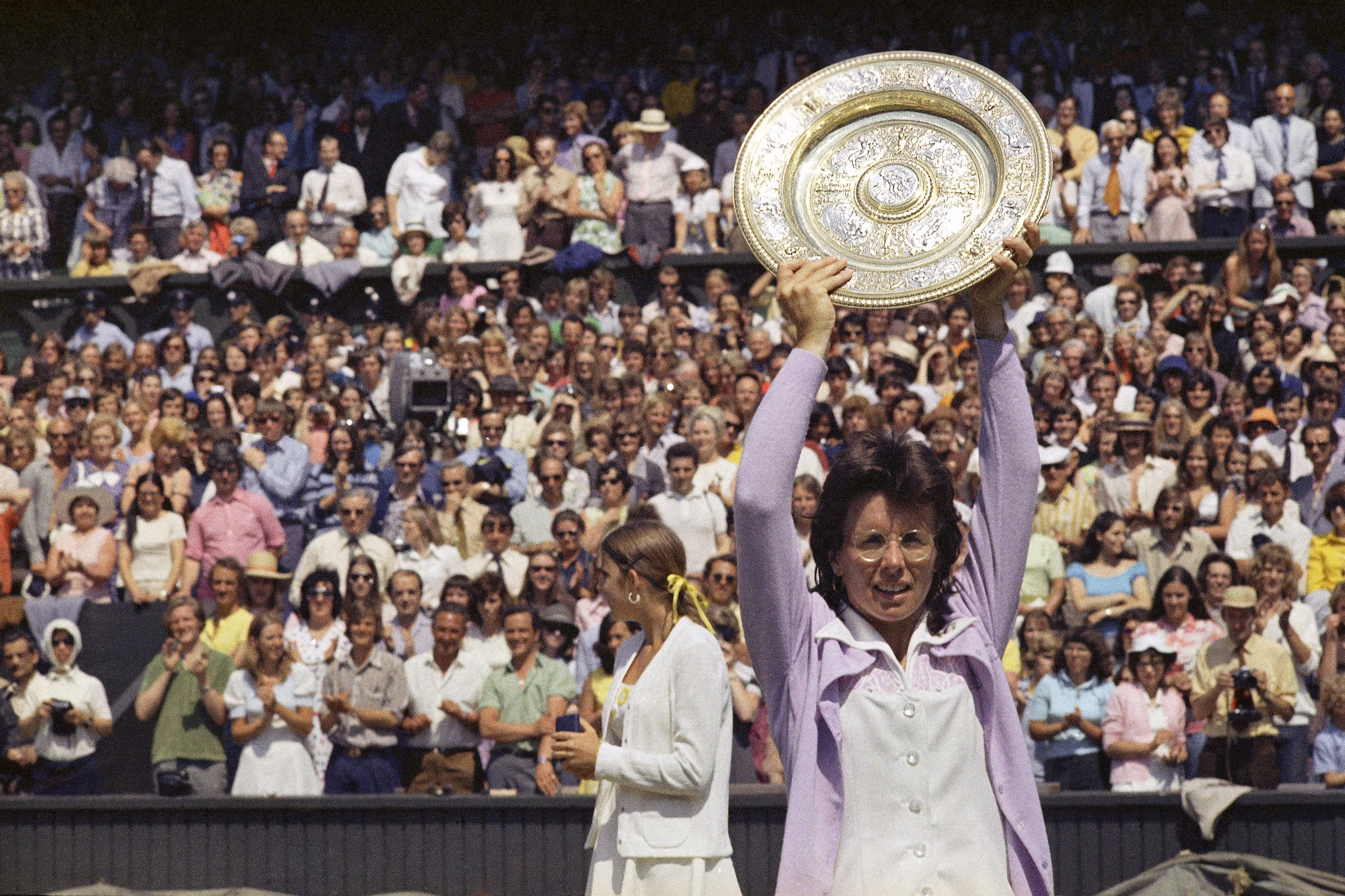 FILE - In this July 7, 1973, file photo, Billie Jean King holds up the championship trophy after defeating Chris Evert in the Wimbledon women's singles final in London. This was King's fifth time winning Wimbledon. (AP Photo/File)