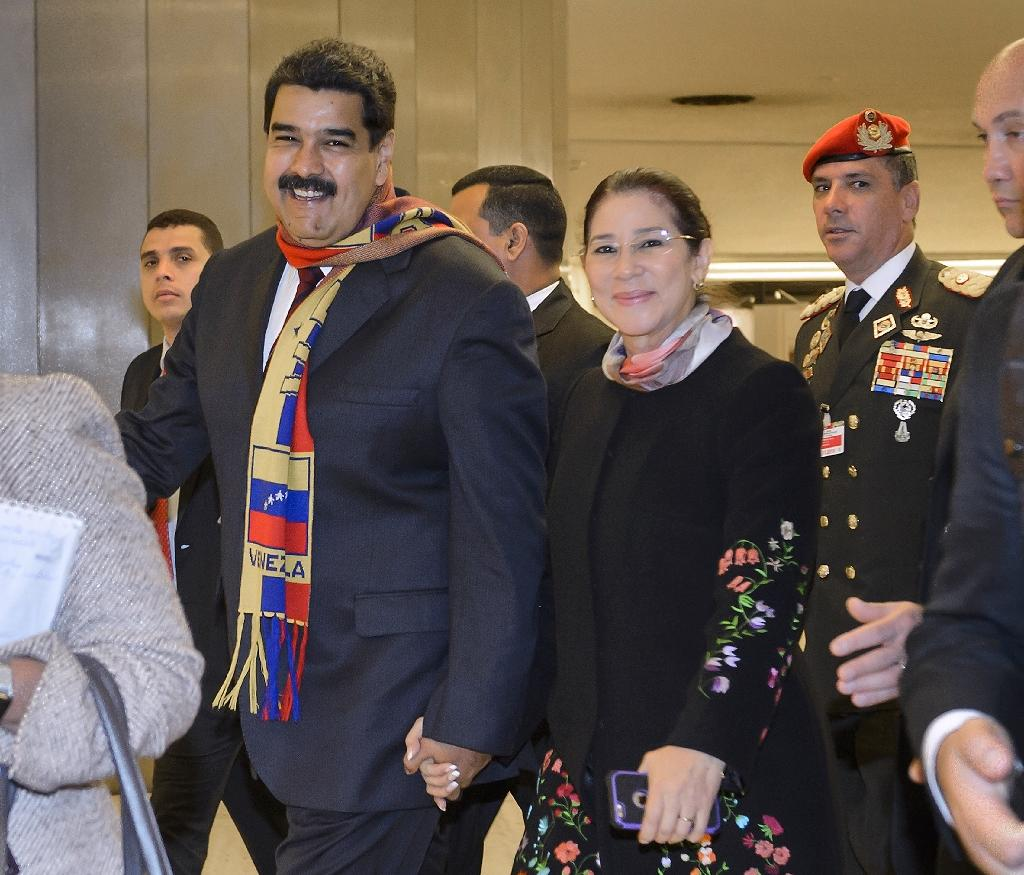 Venezuela's President Nicolas Maduro, with his wife Cilia Flores, leaves the United Nations offices in Geneva after addressing the UN human rights council on November 12, 2015 (AFP Photo/Fabrice Coffrini)