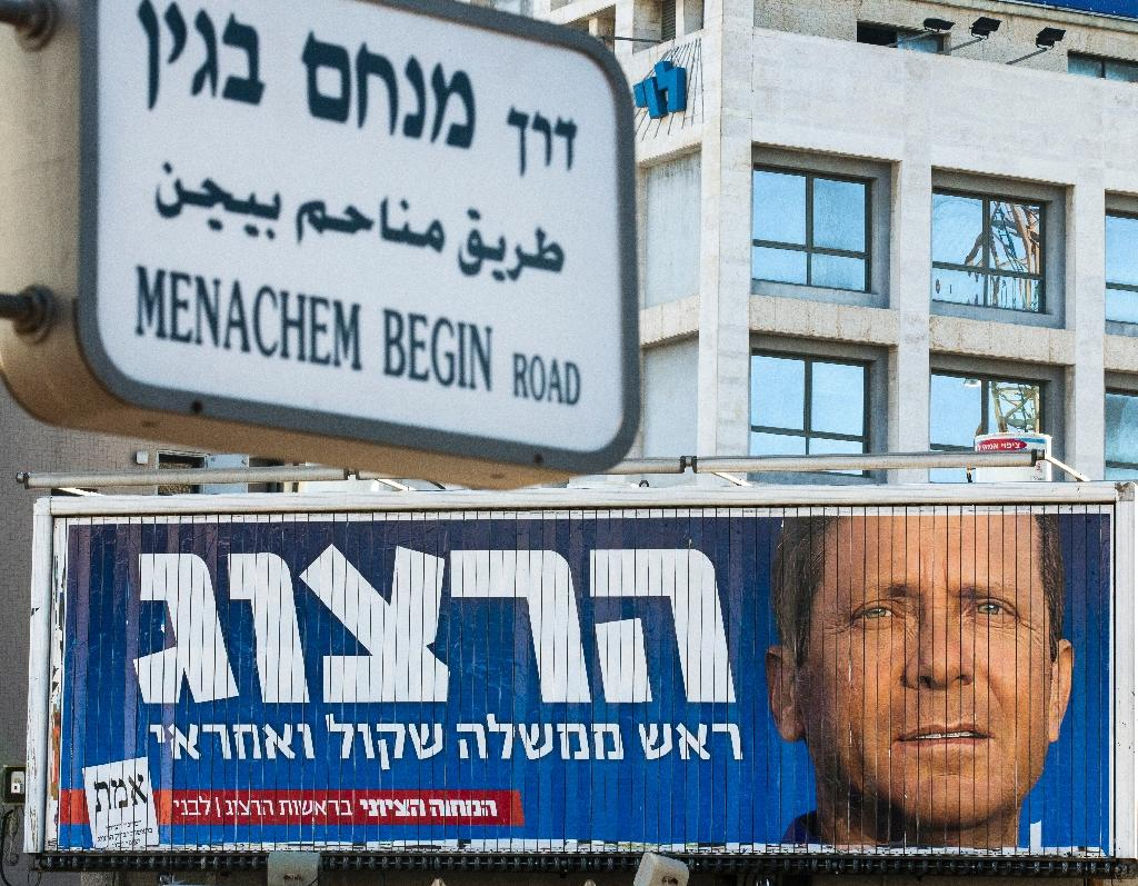 A giant campaign billboard rotates showing Israeli MP Labour Party leader and co-leader of the Zionist Union party Isaac Herzog on March 14, 2015, in the coastal Israeli city of Tel Aviv (AFP Photo/Jack Guez)
