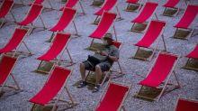 EU tries to save virus aid plan as global deaths surge