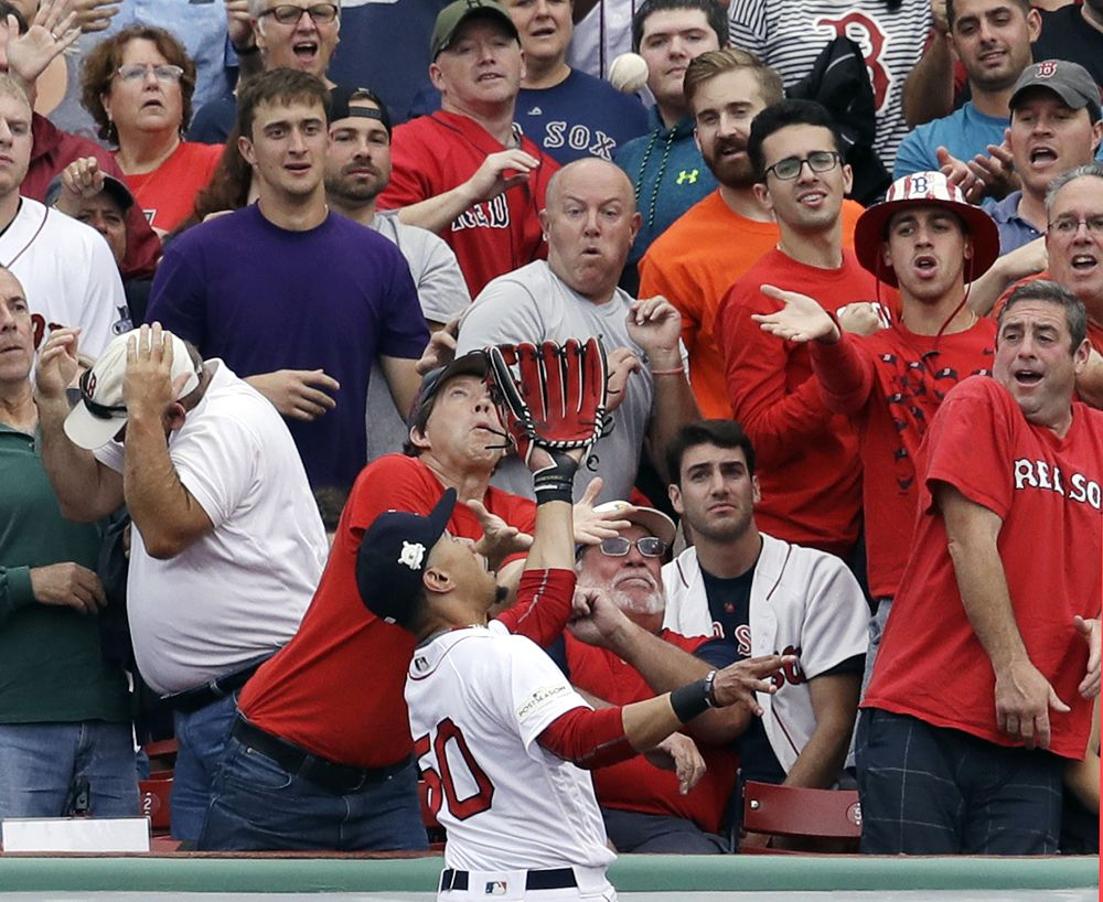 Red Sox right fielder Mookie Betts goes to the wall to catch a fly ball by Houston Astros' Josh Reddick during Game 3 of the ALDS. (AP)