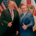 Trump repeatedly denies knowing key impeachment figure despite being photographed with him