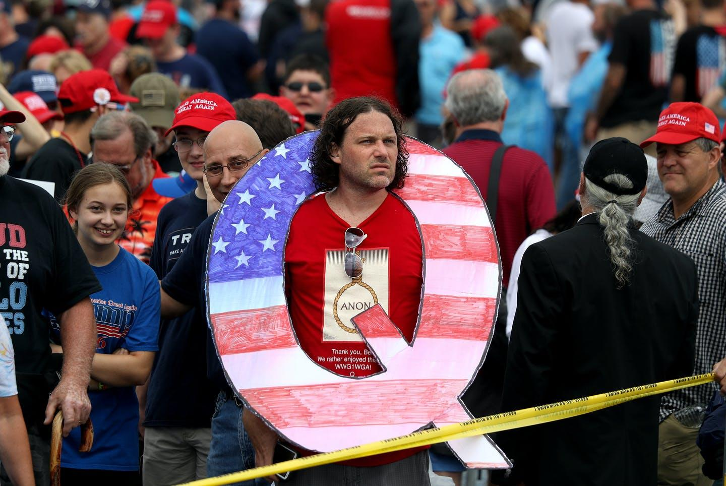 "<span class=""caption"">The big question looming over QAnon: What happens after March 4?</span> <span class=""attribution""><a class=""link rapid-noclick-resp"" href=""https://www.gettyimages.com/detail/news-photo/david-reinert-holds-a-large-q-sign-while-waiting-in-line-on-news-photo/1009769900?adppopup=true"" rel=""nofollow noopener"" target=""_blank"" data-ylk=""slk:Rick Loomis/Getty Images"">Rick Loomis/Getty Images</a></span>"