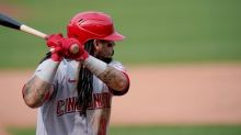 Miller hit batter, walk, wild pitch lifts Reds over Cards