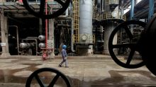 Oil falls to seven-month low on more signs of growing crude glut