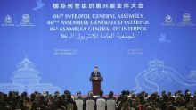 Lawyers say China is using Interpol to seek dissident's return
