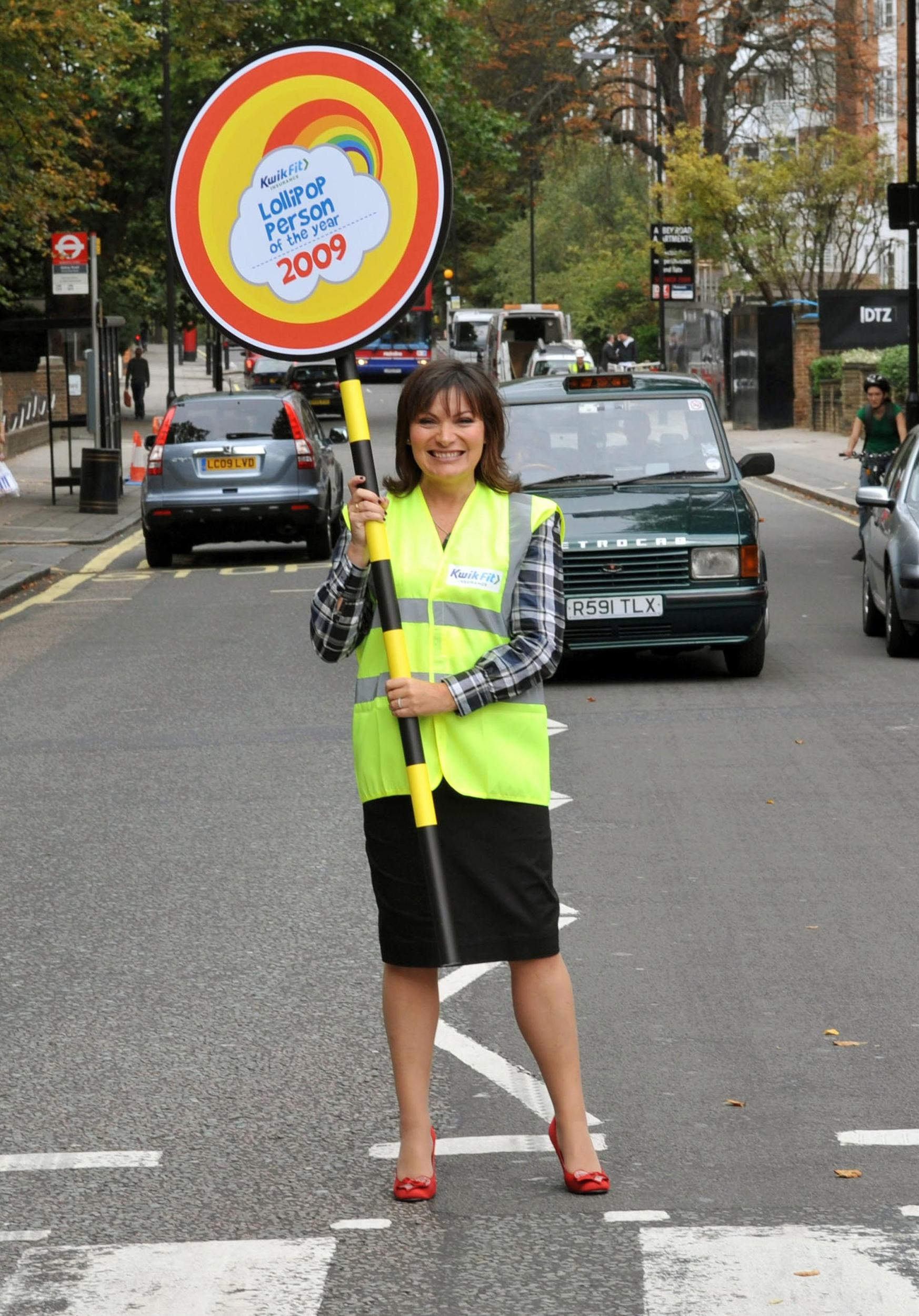 TV presenter Lorraine Kelly stops the traffic at the Abbey Road pedestrian crossing, in London, during the launch of the Lollipop Person of the Year Awards 2009.