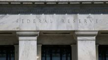 Analysis: Rising economic risks, but Fed likely won't tweak bond-buying for now
