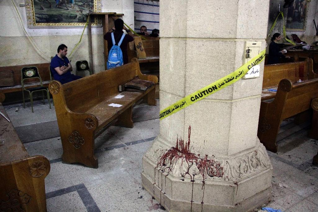 Blood stains a column in the Mar Girgis Coptic Orthodox Church in Tanta, Egypt, after a bomb killed 27 people on Palm Sunday. Analysts say Islamic State group jihadists are lashing out as they come under pressure in Iraq and Syria (AFP Photo/STRINGER)