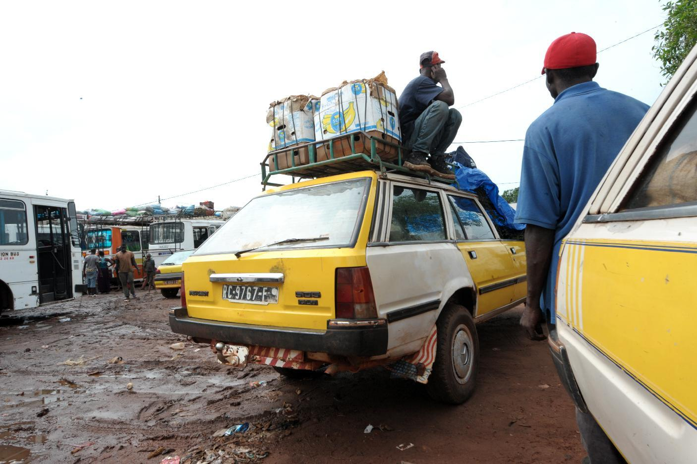 Vehicles wait for police clearance to drive across the border into neighboring Guinea from Senegal's southern border region on September 3, 2014