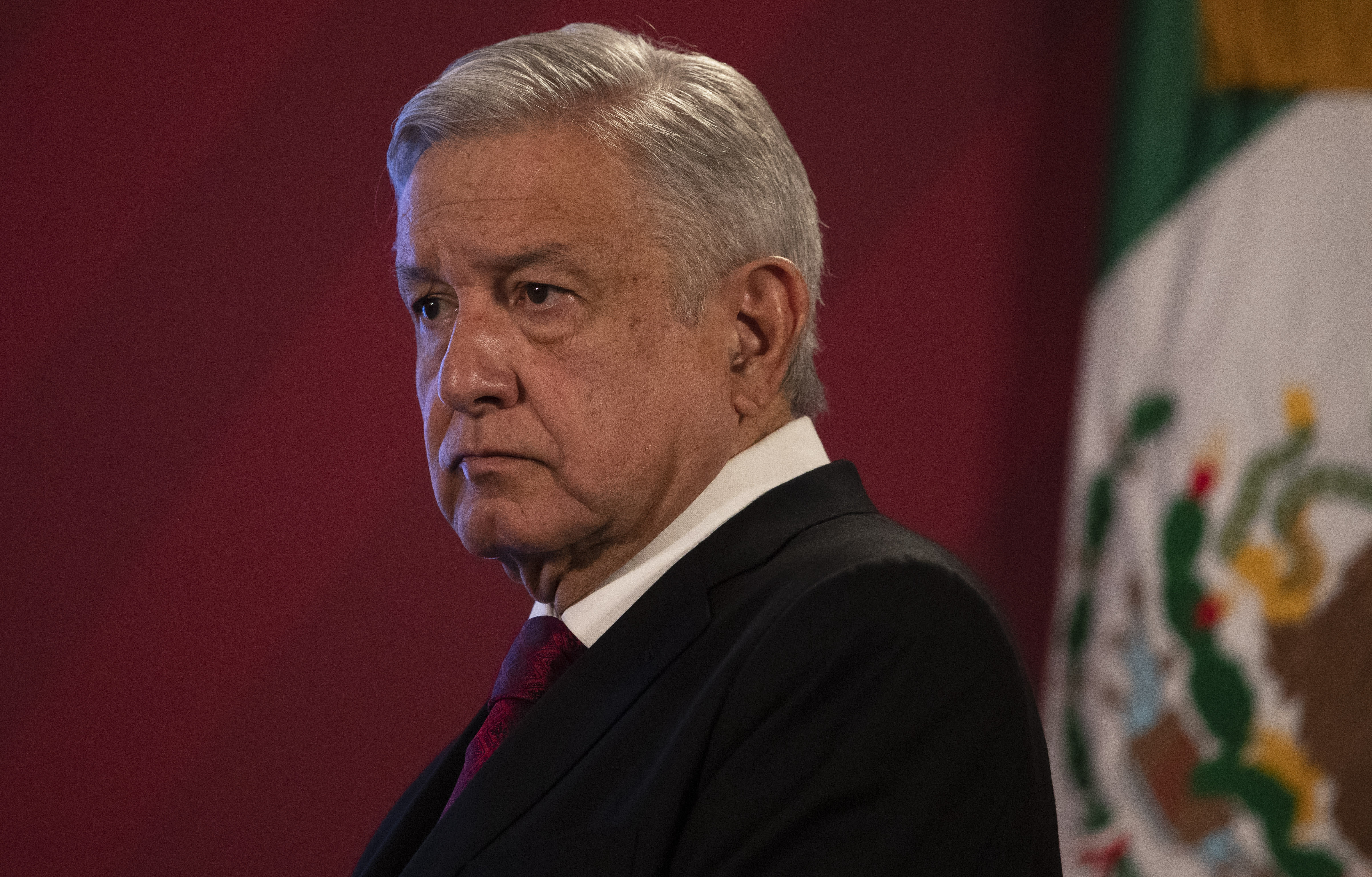 Mexico's President Andres Manuel Lopez Obrador arrives for his daily, morning news conference at the presidential palace, Palacio Nacional, in Mexico City, Monday, July 13, 2020. (AP Photo/Marco Ugarte)