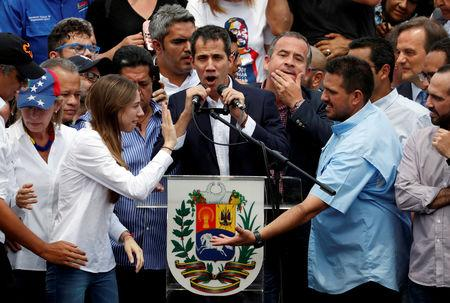 FILE PHOTO: Venezuelan opposition leader Juan Guaido, who many nations have recognized as the country's rightful interim ruler, talks to supporters during a rally against Venezuelan President Nicolas Maduro's government in Caracas, Venezuela March 4, 2019. REUTERS/Carlos Garcia Rawlins/File Photo