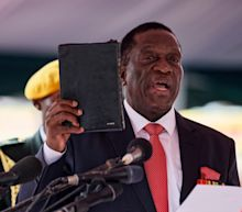 President Emmerson Mnangagwa promises to pay compensation for land grabs and clean up Zimbabwe's 'poisoned politics' as he is sworn in