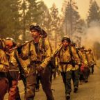 California wildfires force more evacuations as crews rush to make progress before weather shift