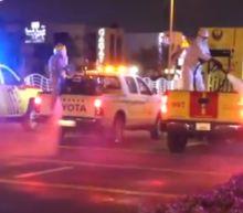 As Coronavirus Cases Rise, Dubai Civil Defense Sprays Disinfectant in Public Areas
