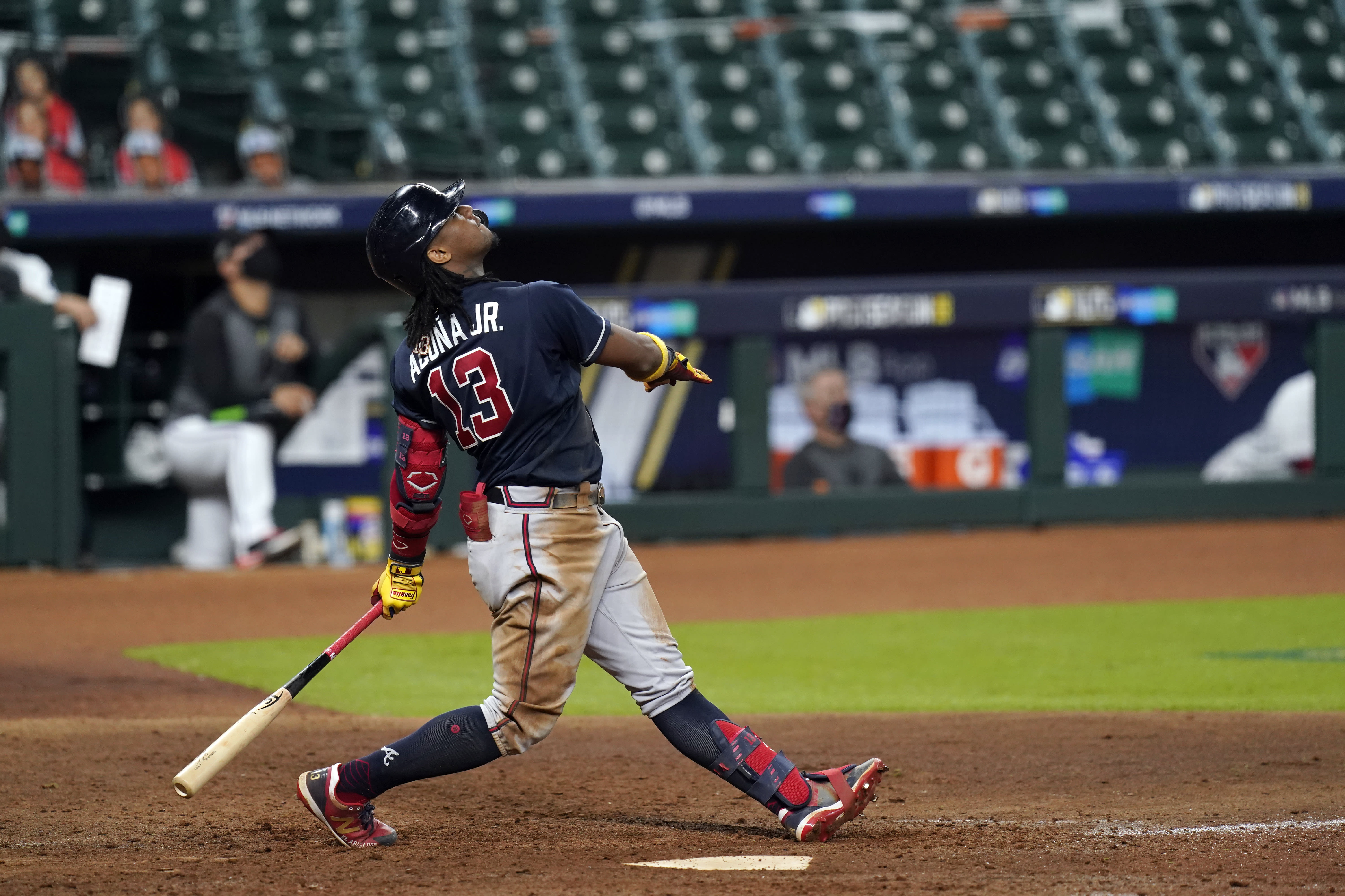 Atlanta Braves' Ronald Acuna Jr. flies out in the eighth inning against the Miami Marlins in Game 3 of a baseball National League Division Series, Thursday, Oct. 8, 2020, in Houston. (AP Photo/Eric Gay)