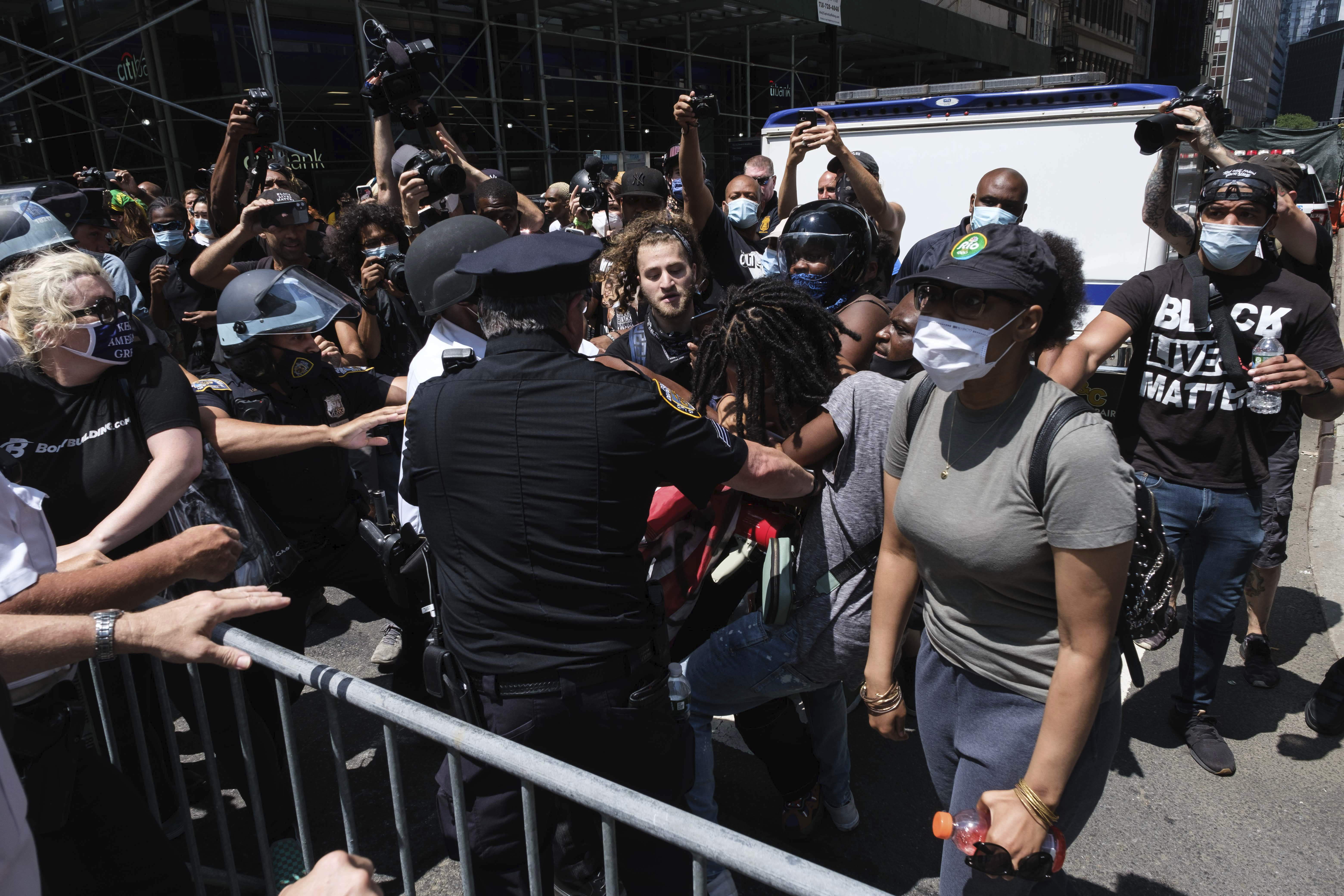 Black Lives Matter protesters and NYPD officers have confrontation near City Hall Park, Wednesday, July 15, 2020, in New York. (AP Photo/Yuki Iwamura)