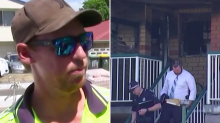Heroic tradies desperately try to help man trapped in apartment fire