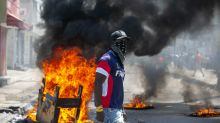 Haitian police, protesters clash; president calls for unity