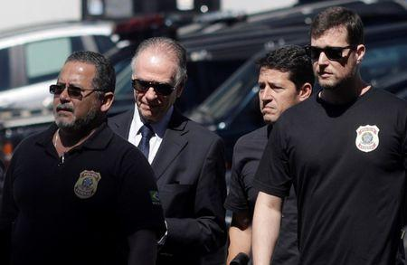 Brazilian Olympic Committee (COB) President Carlos Arthur Guzman arrives to Federal Police headquarters in Rio de Janeiro