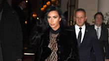 Kim Kardashian Steps Out in Paris Wearing a Daring Sheer Leopard Print Catsuit
