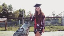 Woman poses with 14-foot-long alligator for college graduation photos: 'He's like a puppy'