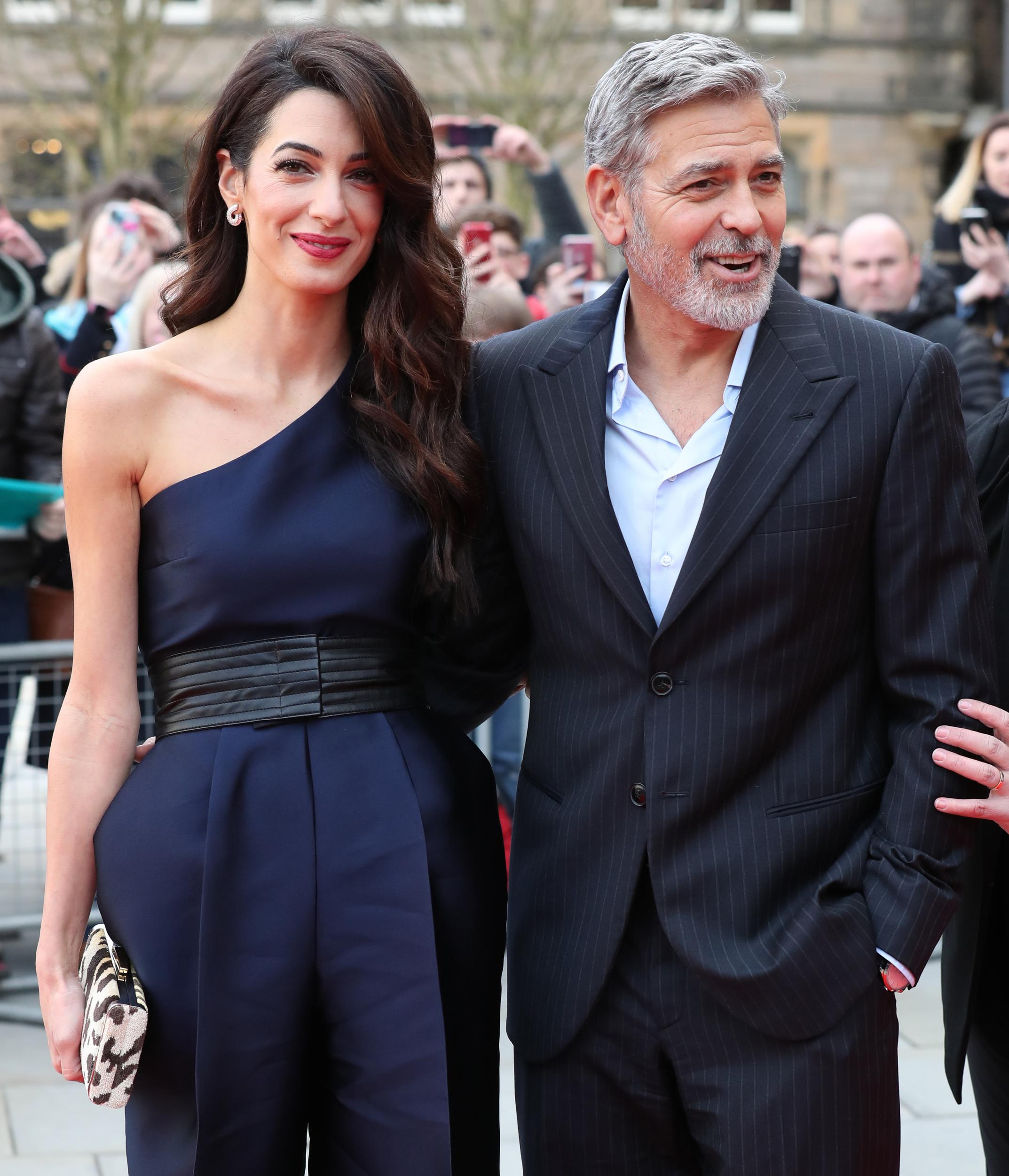 George and Amal Clooney, representing the Clooney Foundation for Justice, arrive at the People's Postcode Lottery charity gala at the McEwan Hall in Edinburgh.