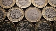 British pound edges higher as May's government survives no-confidence vote