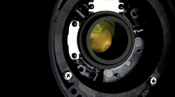 Canon 18-55mm lens torn open to expose visuals of Image Stabilization (video)