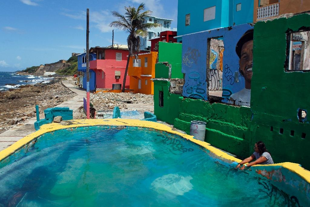 """With the video for pop hit """"Despacito"""" on the verge of becoming the most watched on YouTube, a Puerto Rican barrio once burdened with a bad reputation is now a tourist hot spot (AFP Photo/Ricardo ARDUENGO)"""