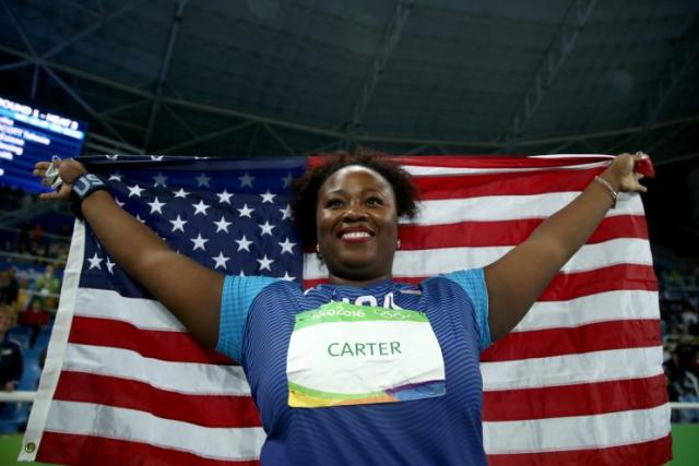Michelle Carter carries an American flag after winning gold in the shot put at the 2016 Olympics. (Getty)