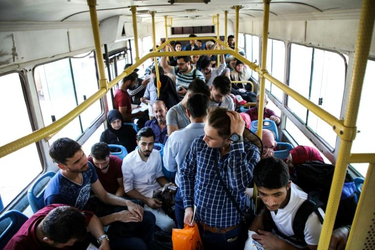 These Syrians were bussed into the country's last opposition bastion of Idlib after being deported by Turkey (AFP Photo/Aaref WATAD)