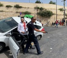 Palestinians stone Israeli car, which crashes, as Jerusalem seethes