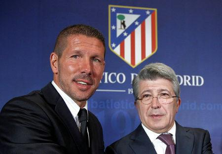 FILE PHOTO: Former Argentina captain Simeone and Atletico Madrid President Cerezo pose for photographers at Simeone's presentation as new coach at Vicente Calderon stadium in Madrid