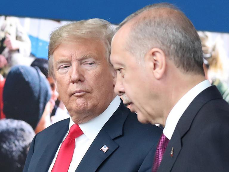 Erdogan accuses US of waging economic 'war' against Turkey as he threatens to 'look for new allies'