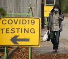 100,000 COVID infections recorded in a week for first time, according to government figures