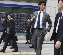 Asian shares mostly up, cheered by Wall Street buying spree