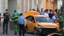Taxi ploughs into Moscow crowd including soccer fans, injuring seven